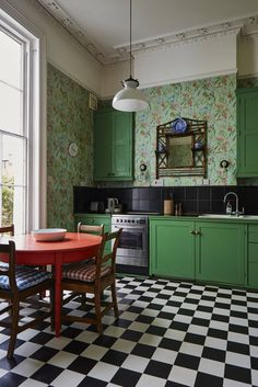 A sink and oven stand in front of the chimney breast and fitted cabinets fill the recesses on either side. The Cole & Son floral wallpaper inspired the bright green of the cabinets and the coral red of the table. Bamboo shelving holds blue and white china Home Decor Kitchen, Kitchen Interior, New Kitchen, Vintage Kitchen, Home Kitchens, Kitchen White, Kitchen Ideas, Blue Green Kitchen, Eclectic Kitchen
