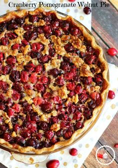 CRANBERRY POMEGRANATE WALNUT PIE. Ooey gooey brown sugary goodness combined with walnuts and caramelized fruit!