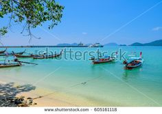 Traditional Thai boats for tourist near the beach Thailand. Panwa Bay Phuket