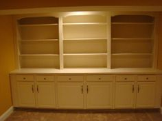 I want something like this when we finish the basement. But maybe some cabinets with glass doors up above.