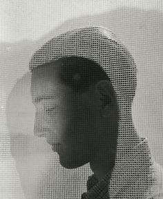 Herbert List - Boy in profile behind drapes - Hamburg (1932)
