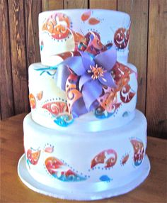 3 tier round wedding cake with large rainbow paisley custom gumpaste flower