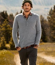 Long sleeved gray top with crisp undershirt and cargo pants