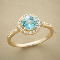 Astonishingly brilliant white sapphires bring star shine to an apatite so clear it defines perfection.