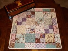 A Quilting Life - a quilt blog: Charm Pack Table Topper!