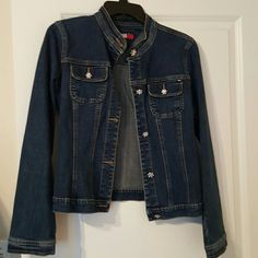 Tommy Hilfiger denim  jacket Blue denim jacket  with rhinestone buttons.  Button at collar is missing  one rhinestone, you have to be very close to see. Too small for me. Tommy Hilfiger Jackets & Coats Jean Jackets