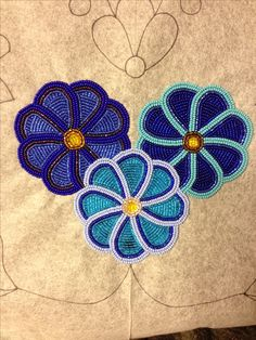 Center flowers on breech cloth- current project. Project is men's traditional outfit ; broadcloth with Ojibwe floral beadwork.