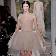 Valentino Haute Couture Gives Us a Whole Other Kind of Swan Song: The first look of the Valentino Spring 2014 Haute Couture collection set the tone, quite literally, for a show inspired by La Traviata: the airy tulle dress was hand-embroidered with the Italian opera's melodies.