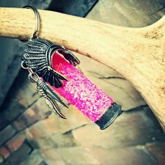 Rustic glittered hot pink shotgun shell keychain with a head dress, arrow and feather.