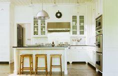 Barbara Westbrook Interiors - Lakehouse Kitchen - light blue/gray beadboard inside glass cabinets