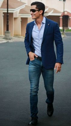 Perfect the smart casual look in a navy blazer jacket and blue jeans. For footwear go down the classic route with black leather oxford shoes. Shop this look on Lookastic: https://lookastic.com/men/looks/blazer-long-sleeve-shirt-jeans/17997 — Light Blue Long Sleeve Shirt — Navy Blazer — Blue Jeans — Black Leather Oxford Shoes — Black Leather Belt — Black Sunglasses