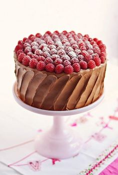 """Red Velvet & Raspberry Supreme Cake (Sweetapolita). """"Super-moist and decadent red velvet cake filled with pink whipped vanilla cream with raspberries, creamy marshmallow cream cheese filling and smothered in a satiny and fluffy chocolate frosting topped with more fresh raspberries."""" Beautiful."""