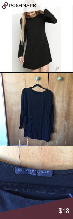 Brandy Melville Black Long Sleeve  Tunic Dress Great staple for any closet! Worn a handful of times, 1 small pull on the backside (note photo) but not noticeable when on. Price reflects this flaw. Very comfy, soft and flattering. Scoop neck. Great to dress up or down. One size fits all. Brandy Melville Dresses Long Sleeve