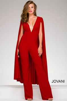 Sexy and contemporary red floor length jersey fitted jumpsuit with plunging v neckline and a cape on the back, also available in black, eggplant and white.