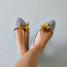 grey shoes with gold satin bows