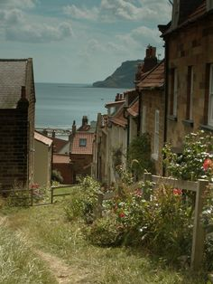 Robin Hood's Bay, Yorkshire, England, this magical seaside village clings precariously to a steep cliff sloping down to the North Sea. It is incredibly pretty and reminiscent of years gone by, when smugglers used to ferry their cargo along its winding streets.