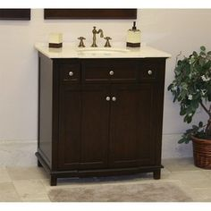 I really like this mahogany for the cabinet and the white porcelain top