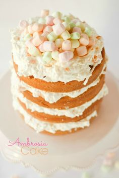 Ambrosia Cake --light and moist cake with marshmallows, whipped cream, mandarin oranges, and coconut.  So SO good!!