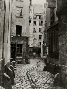 Just uploaded a bunch of Charles Marville's photographs of Paris to Photobucket–go have a look! Marville was specifically tasked with photographing all the streets about to be destroyed in Haussmann's demolitions, so almost all of the places in. Old Pictures, Old Photos, Vintage Photos, Old Photography, Street Photography, Paris Ville, French Photographers, Vintage Paris, Belle Epoque