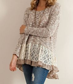 Gorgeous sheer and lightweight cut and sew sweater ruffle tunic top. Features a color block with tones of taupe, cream, and brown. Polyester/cotton blend. imp