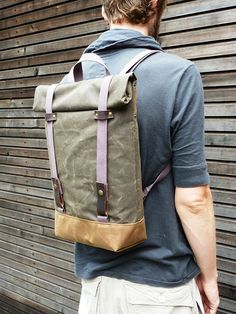 Waxed canvas rucksack/backpack with roll up top and double waxed bottem UNISEX. $159.00, via Etsy.