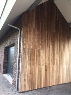 Novawood thermally modified Ash siding makes a wonderful accent addition to this home garage side wall.