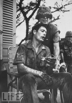 Co Rentmeester, a renowned Vietnam war photographer, after being wounded in action. (1968)