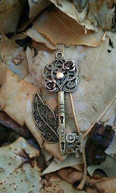 Beautiful Key Pendant with filigree leaf