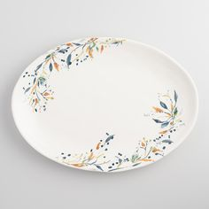 Make a statement when presenting your holiday entrees with our spacious serving platter. Crafted of earthenware with an organic dimpled finish, this stunning platter is finely embellished with an in-glaze decal of a leafy floral motif. www.worldmarket.com #WorldMarket Thanksgiving Entertaining