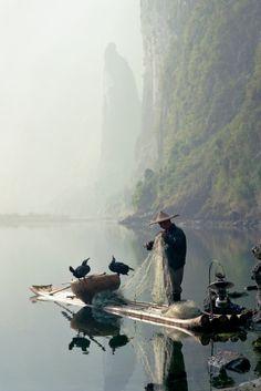 Cormorant fishing on the Li River, Guilin, China.