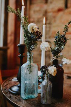 bottle candleholders - photo by Summer Taylor Photography http://ruffledblog.com/moody-whiskey-bar-wedding-inspiration