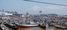 Ghana, West Africa: My view was a lot less fishing boats, adjacent to Elmina Castle with blue waters as far as the eye could see.