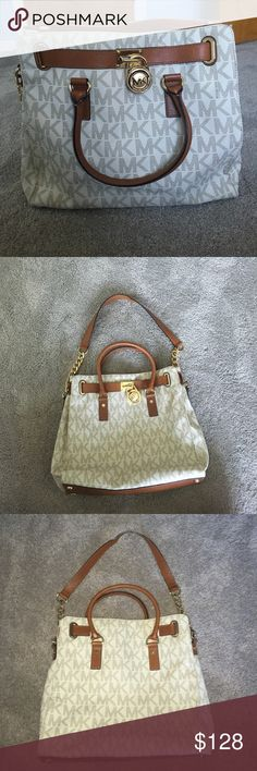 Michael Kors Hamilton Bag Authentic Michael Kors Hamilton bag. Lots of storage and looks brand new. Minor scratch behind lock because the lock hits it (as shown in last picture). Michael Kors Bags Satchels
