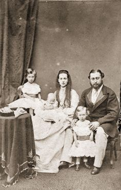 With their parents, King Edward VII and Queen Alexandra, in 1867.  - GoodHousekeeping.com