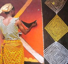 Basotho women of South Africa & Lesotho pray to their ancestors for rain, abundance, & peace by painting & slicing brilliant geometric murals on the mud plaster walls of their houses. Photographed by Courtney-Clarke. via dreamondzine blog