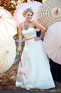 Umbrella backdrop for the bride
