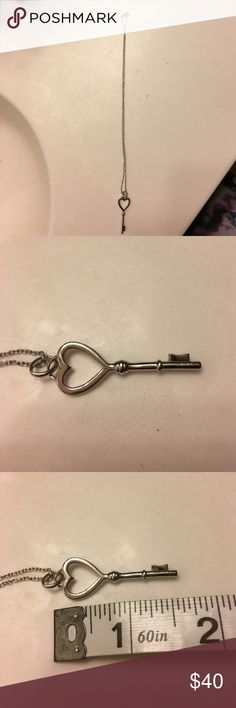 Key necklace Key necklace. Honestly not sure if it's sterling silver or white gold. Charm is 2in, chain is 18 in. Worn very few times. Jewelry Necklaces