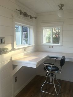 Need some home office inspiration? This Tuff Shed office houses a floral design business! The shiplap, tin plate, and wood laminate floors make this office a total style inspiration.