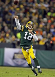 Green Bay Packers Quarterback Aaron Rodgers Throws A Touchdown Pass To Wide Receiver