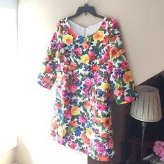 Floral Size Small 3/4 Sleeve Dress This elegant floral dress is not only adorable but very comfortable. It's is a size small with 3/4 length sleeves. You can wear it to any occasion and dress it up with a cardigan and jewelry. Price is firm since I just bought it and it still has the tags. Mosaic Boutique Dresses Long Sleeve