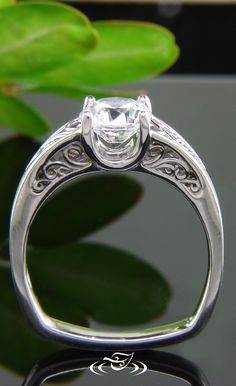Platinum 4-prong with 6 filigree panel mounting Center stone to be about 6-6.5mm