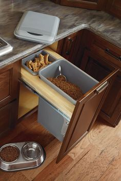 Full extension, floor-mounted glides allow for easy access to this 50-quart wastebasket and trash bag holder. Lids provide neater look and contain odors.