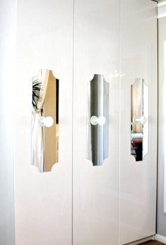 IKEA hacks: Mary Beth loved the look of the closets in the Viceroy Springs Hotel, and set out to recreate the look with some custom cut mirrors she adhered to the fronts. She later switched out the knobs for something even more special.