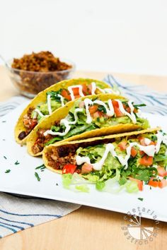 These vegan Loaded Black Bean Tofu Tacos with Walnut Crumble are delicious, easy to make, packed with veggies and protein, and family friendly!