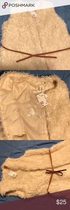HM vest, size 6. New with tags, white fur H and M vest with suede tie, string belt loops, no buttons or closures, lined. Size 6, no pockets. Very cute! HM Jackets & Coats Vests