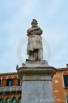 Nicolo Tommaseo famous statue, doves and historical buildings, in S. Stefano square, in Venice, Italy.