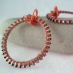 these hoop earrings wire made with zippers and copper wire from TheFamiLeeJewels
