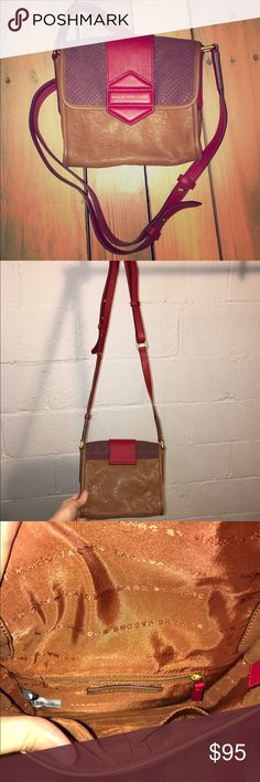 Marc jacobs brown and red leather cross body purse Great condition.  No stains, tears, or holes.  •I bundle & discount bundles •If an item is higher than you want to pay, message an offer or favorite & wait for price to drop weekly.  •My mannequin is Xsm so sometimes items appear loose or I clip back for actual look/fit •Usually ships within 24 hrs and latest 48 hours unless otherwise noted.  •Some of my items are various sizes because I sell for sister as well. #marcjacobs #crossbody #purse…
