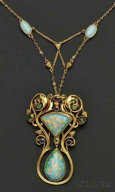 An Art Nouveau black-onyx-backed opal, demantoid garnet, sapphire, amethyst, green tourmaline, peridot, and gold necklace.