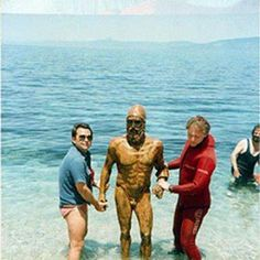 One of the Riace Bronzes emerging from the sea, 40 years ago. The Riace bronzes were discovered August 16, 1972. The classical Greek statues were spotted partly buried in the sand by a snorkeler, Stefano Mariottini, about 300 meters off the cost of Riace, near Reggio Calabria, Italy. They came out of the sea four days later, and are housed in the Museo Nazionale della Magna Grecia in Reggio Calabria, Italy.